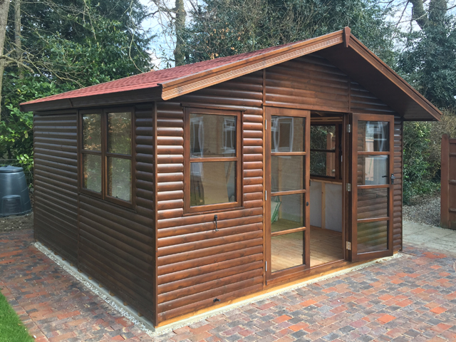 "<p id=""boldtitle"">Gainsborough Chalet</p>12 x 14 in Loglap Cladding<br/>Red Felt Tiles.<br/>Stained."