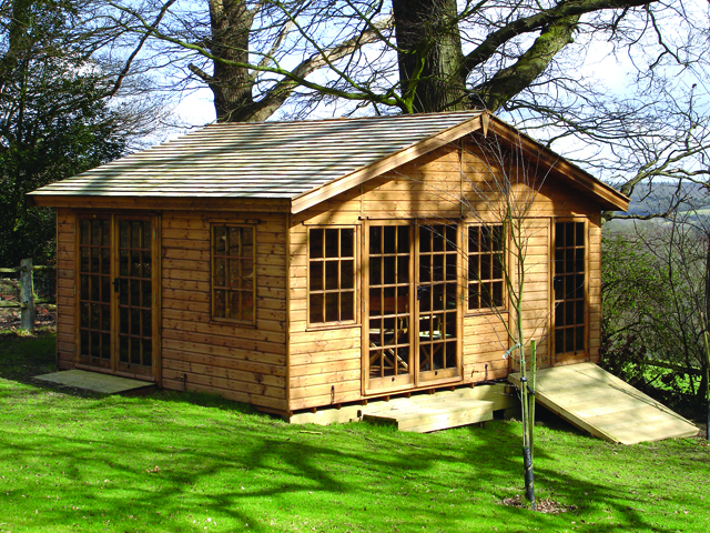 "<p id=""boldtitle"">Bespoke Summerhouse</p>Bespoke Summerhouse<br/>13'6""' x 17' 6"" (4115mm x 5335mm) gable in T&G shiplap.  <br/>Shown with georgian doors/windows, cedar shingle roof tiles.  <br/>With ramps and platform base.<br/>"