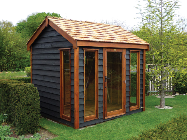 "<p id=""boldtitle"">Bespoke Summerhouse</p>Bespoke gable garden summerhouse in rustic prepared weatherboard.  Higher pitch roof, fully glazed doors/windows, cedar shingle tiles.  Stained.<br/>"