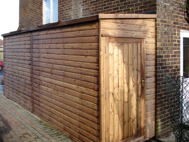 "<p id=""boldtitle"">Bespoke Lean To </p>20' x 4' (6100mm x 1220mm) pent lean to in T&G shiplap with fully framed joinery door either end and two polycarbonate roof lights.<br/>"