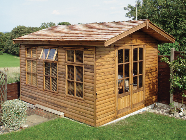 "<p id=""boldtitle"">Bespoke Summerhouse </p>11' x 9' (3355mm x 2745mm) gable summerhouse in loglap with Hawkins doors and windows.  Roof overhang and cedar shingle tiles.<br/>"