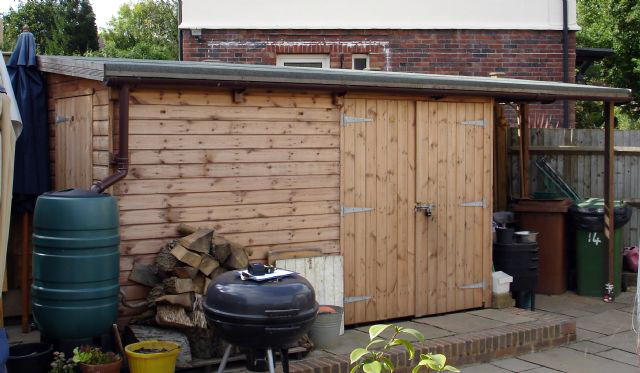 "<p id=""boldtitle"">Bespoke Toolstore/logstore </p>Bespoke pent toolstore/logstore in T&G shiplap cladding.  Additional side end door, roof overhang, guttering and water butt.<br/>"
