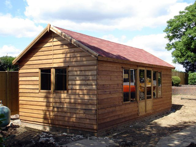 "<p id=""boldtitle"">Bespoke Garden Room </p>24' x 12' (7320mm x 3660mm) gable in rustic prepared weatherboard cladding.  7' (2135mm) to eaves with 30 degree pitch roof and felt tiles.<br/>"