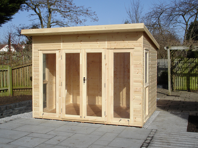 "<p id=""boldtitle"">Bespoke Garden Studio </p>12' x 8' (3660mm x 2440mm) pent garden studio in T&G shiplap cladding. Fully glazed doors/windows.  Left untreated for customer to paint.<br/>"