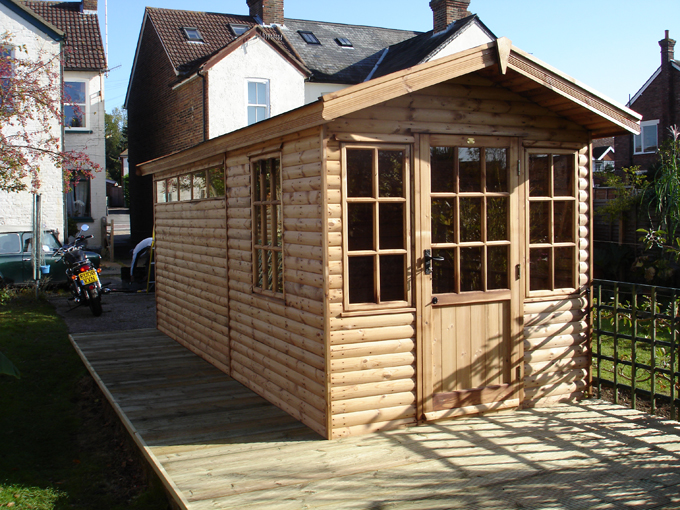 "<p id=""boldtitle"">Bespoke Summerhouse/storage</p>Bespoke gable summerhouse/storage in loglap cladding.  Fully framed double doors with security windows one end for storage.  Georgian style windows/doors for summerhouse at the other.  Felt tiles.<br/>"