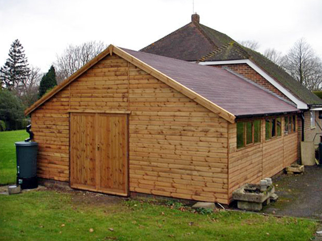 "<p id=""boldtitle"">Bespoke Lean To </p>24' x 19' (7320mm x 5790mm) gable lean-to in T&G shiplap.  30 degree pitch roof, 7' (2135mm) wide double doors and brown felt roof tiles.<br/>"