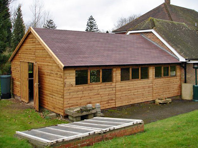 "<p id=""boldtitle"">Bespoke Summerhouse/storage</p>24' x 19' (7320mm x 5790mm) gable lean-to in T&G shiplap.  30 degree pitch roof, 7' (2135mm) wide double doors and brown felt roof tiles.  Side view."