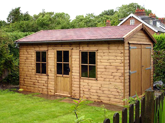 "<p id=""boldtitle"">Bespoke Summerhouse/store </p>16' x 10' (4880mm x 3050mm) gable summerhouse and store in T&G shiplap.  With Jasmin door and windows, garage double doors, red felt roof tiles and guttering.<br/>"