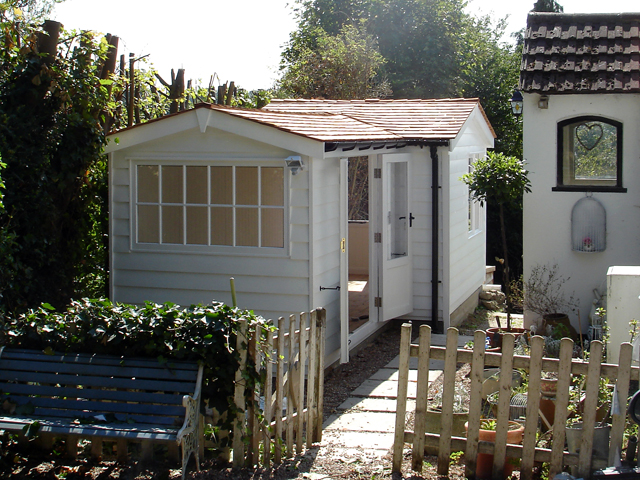 "<p id=""boldtitle"">Bespoke Garden Office</p><br/>Bespoke garden office in prepared weatherboard cladding to fit small space, insulated and lined, double glazed, cedar shingle tiles.  Painted.<br/>"