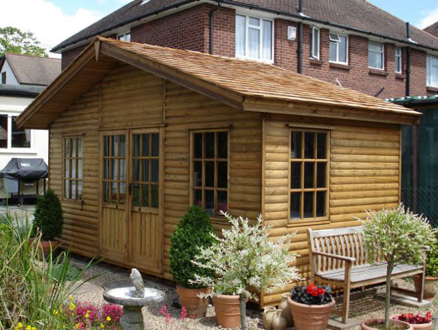 "<p id=""boldtitle"">Brooke Chalet </p>8' x 12' (2440mm x 3660mm) Brooke chalet with optional loglap cladding, cedar shingle roof, guttering and water butt.<br/>"
