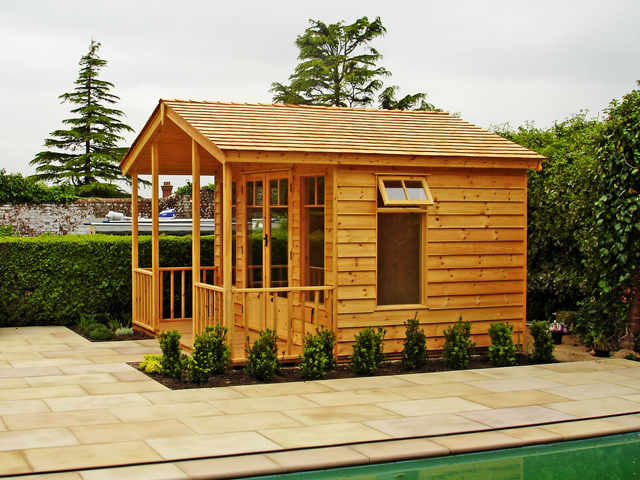 "<p id=""boldtitle"">Gainsborough Chalet </p>10' x 12' (3050mm x 3660mm)  Gainsborough chalet in standard prepared weatherboard cladding. Shown with optional different window design, 4' (1220mm) verandah and cedar shingle roof tiles.<br/>"