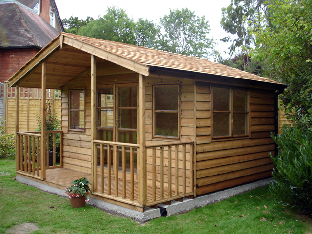 "<p id=""boldtitle"">Gainsborough Chalet </p>10' x 14' (3050mm x 4270mm) Gainsborough chalet in standard prepared weatherboard. Shown with optional 4' (1220mm) verandah, cedar shingle tiles, double glazed windows and interior lined with T&G.<br/>"