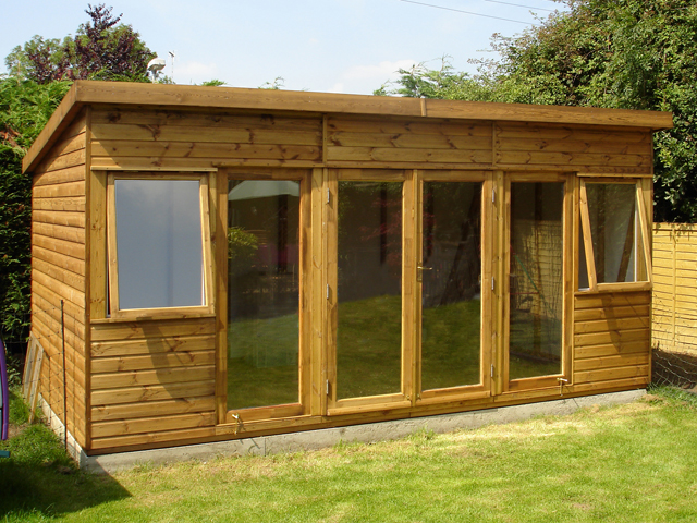 "<p id=""boldtitle"">Garden Home Office </p>16' x 9' (4880mm x 2745mm) pent garden home office in standard T&G shiplap cladding.  Shown with extra door and two fixed glass panels.<br/>"