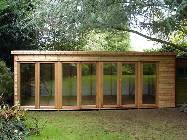 "<p id=""boldtitle"">Garden Artist Studio</p>22' x 10' (6710mm x 3050mm) pent artist's studio.  Shown with optional extra doors and fully glazed panels.<br/>"