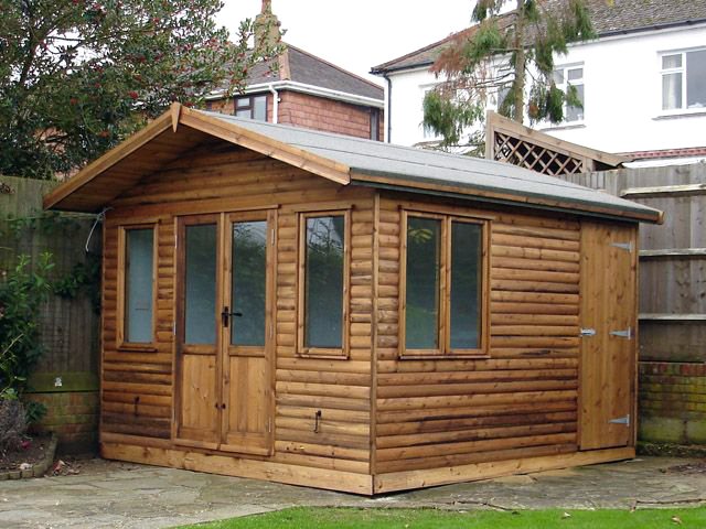 "<p id=""boldtitle"">Garden Room<br/></p> 11' x 10' (3355mm x 3050mm) gable garden home office.  Shown with optional loglap cladding, extra door/window, internal partition and ledged and braced door.<br/>"