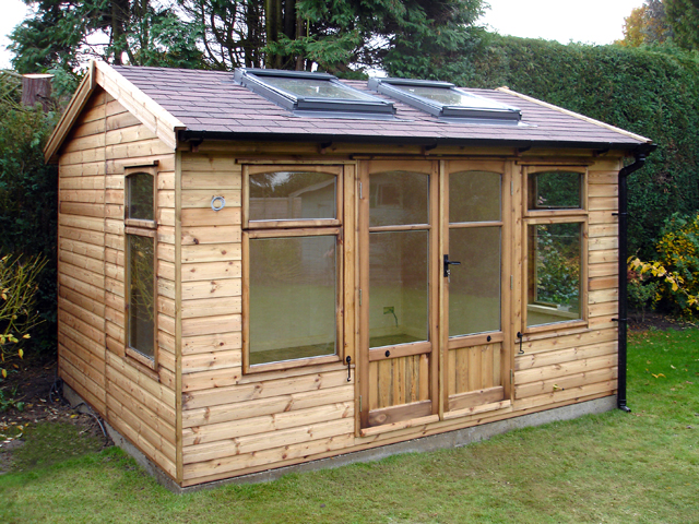 "<p id=""boldtitle"">Garden Home Office</p>10' x 8' (3050mm x 2440mm) gable garden home office.  Shown with optional Hawkins design windows/doors.  Velux windows and felt tiles.<br/>"