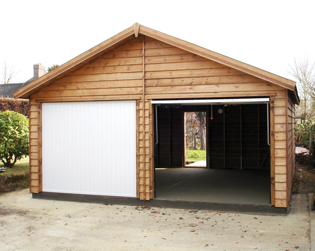 "<p id=""boldtitle"">Gable Garage</p>18' x 18' (5490mm x 5490mm) gable garage.  Shown with optional prepared weatherboard cladding, up and over doors and personal door.<br/>"