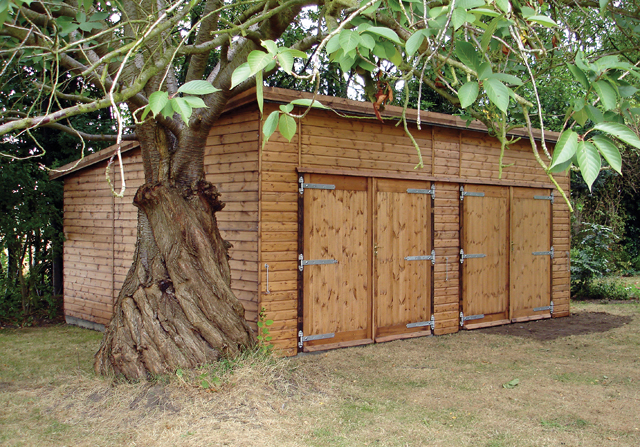 "<p id=""boldtitle"">Pent Double Garage</p>20' x 16' (6100mm x 4880mm) pent double garage in T&G shiplap.  With optional additional set of double doors.<br/>"
