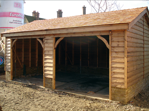 "<p id=""boldtitle"">Gable Garage </p>20' x 13' (6100mm x 3960mm) open garage/tractor/car port.  With optional weatherboard cladding, cedar shingle tiled roof and fitted onto a dwarf wall.<br/>"