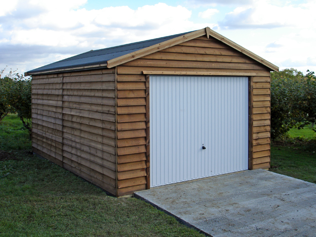"<p id=""boldtitle"">Gable Garage </p>20' x 12' (6100mm x 3660mm) gable garage.  Shown with optional rustic weatherboard cladding and up and over door.<br/>"
