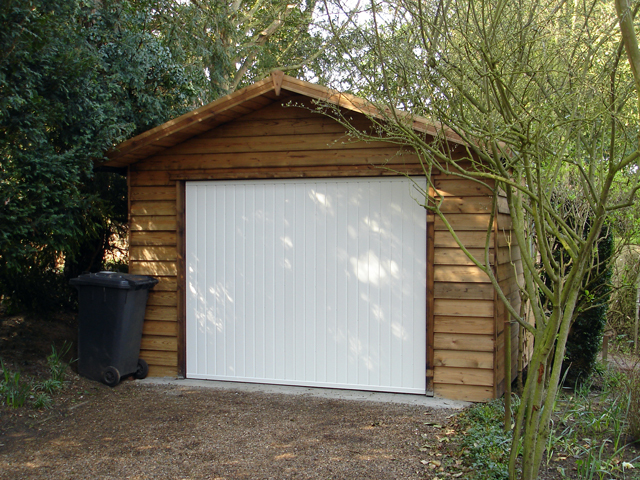 "<p id=""boldtitle"">Gable Garage </p>24' x 12' (7320mm x 3660mm) gable garage. Shown in optional prepared weatherboard cladding with metal up and over door.<br/>"