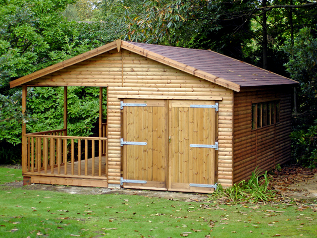 "<p id=""boldtitle"">Gable Garage </p>21' x 16' (6100mm x 4880mm) gable garage with attached verandah.  Shown with optional loglap cladding and brown felt roof tiles.<br/>"