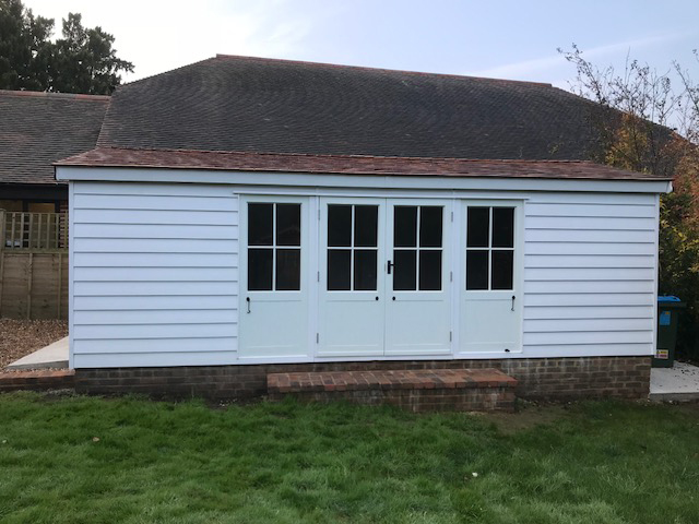 "<p id=""boldtitle"">Bespoke Garage</p>6m x 3.3m Bespoke painted Garage - side view.<br/>Made to customers requirements."
