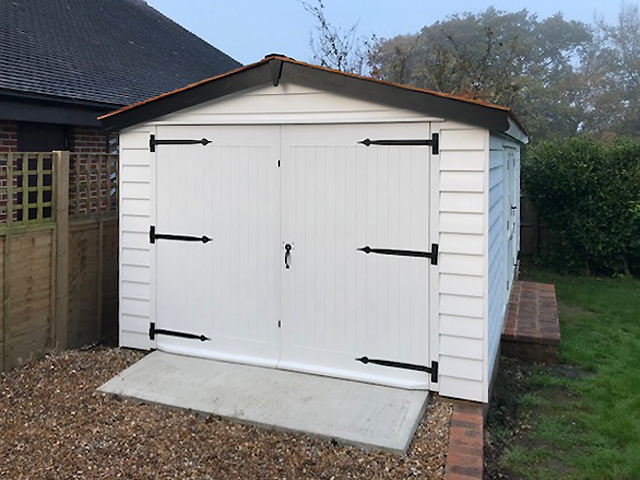 "<p id=""boldtitle"">Bespoke Garage</p>6m x 3.3m Garage in Prepared Weatherboard Cladding.<br/>Painted.<br/>Cedar Shingle Tiled Roof."