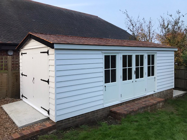 "<p id=""boldtitle"">Bespoke Garage</p>6.6m x 3m Painted Garage<br/>Cedar Shingle Tiles.<br/>Made to customers requirements.<br/>Base and brickwork by Larkin Enterprises Ltd."