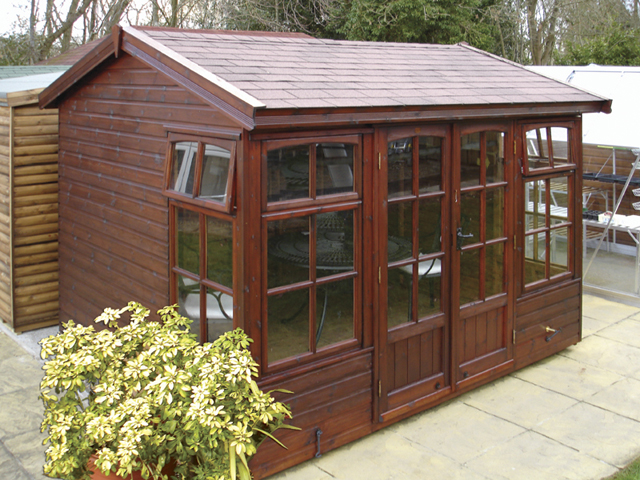 "<p id=""boldtitle"">Hawkins Chalet<br/></p>10' x 8' (3050mm x 2440mm) Hawkins chalet in standard T&G shiplap cladding.  Shown with optional brown felt tiles and stained with Timbertone in American Walnut.<br/>"