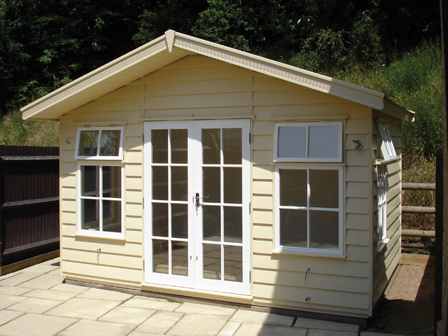 "<p id=""boldtitle"">Hawkins Chalet<br/></p> 8' x 10' (2440mm x 3050mm) Hawkins chalet. Shown in optional prepared weatherboard cladding, painted and with transverse roof.  On a concrete base.  <br/>"