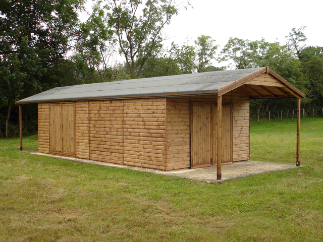 "<p id=""boldtitle"">Heavy Duty Workshop</p>24' x 12' (7320mm x 3660mm) gable workshop in T&G shiplap.  <br/>With two optional 6' (1830mm) roof overhangs and extra 2 x 6' (1830mm) wide double doors.<br/>"