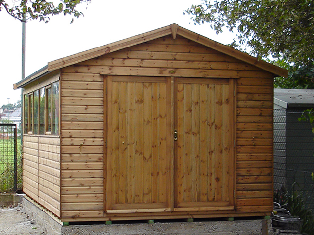 "<p id=""boldtitle"">Heavy Duty Workshop</p>12' x 10' (3660mm x 3050mm) gable workshop in T&G shiplap. <br/>With optional 6' (1830mm) double doors.<br/>"