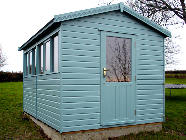 "<p id=""boldtitle"">Heavy Duty Workshop</p>12' x 8' (3660mm x 2440mm) gable workshop in T&G shiplap.  <br/>Shown with optional half glazed door and painted.  <br/>On concrete base and bearers with dpc.<br/>"