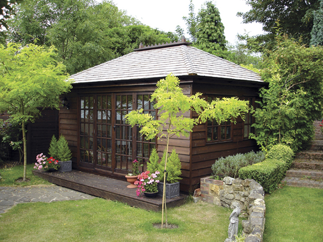 "<p id=""boldtitle"">Hip Roofed Summerhouse<br/></p>16' x 11' (4880mm x 3355mm) hip roofed summerhouse.  Shown with optional window panels, cedar shingle tiles and ridge finial.  Stained.<br/>"