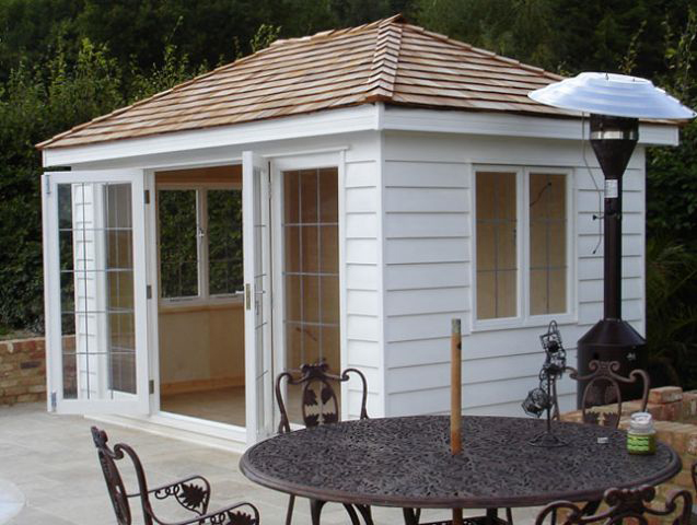 "<p id=""boldtitle"">Hip Roofed Summerhouse<br/></p> 12' x 8' (3660mm x 2440mm) hip roofed summerhouse.  Shown with optional cedar shingle tiles, leaded doors and windows, insulated and lined with birch ply.  Painted white.<br/>"