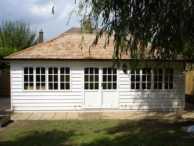 "<p id=""boldtitle"">Hip Roofed Summerhouse<br/></p>24' x 12' (7320mm x 3660mm) hip roofed summerhouse.  Shown with optional cedar shingle tiles and guttering, extra windows and painted white.<br/>"