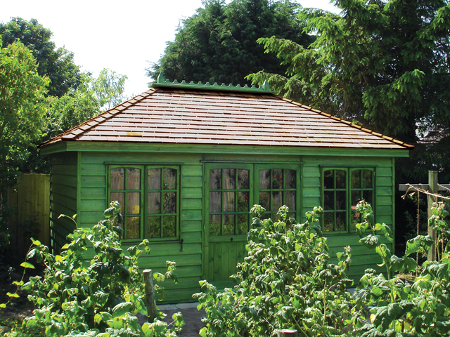 "<p id=""boldtitle"">Hip Roofed Summerhouse<br/></p>16' x 10' (4880mm x 3050mm) hip roofed summerhouse.  Shown with optional cedar shingle tiles and ridge finial.  Stained with Sadolin Classic in Deep Green.<br/>"
