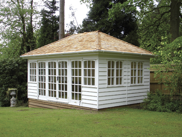 "<p id=""boldtitle"">Hip Roofed Summerhouse<br/></p>16' x 11' (4880mm x 3355mm) hip roofed summerhouse.  Shown with optional cedar shingle tiles, guttering and down pipe.  Extra doors and windows.  Painted white<br/>"