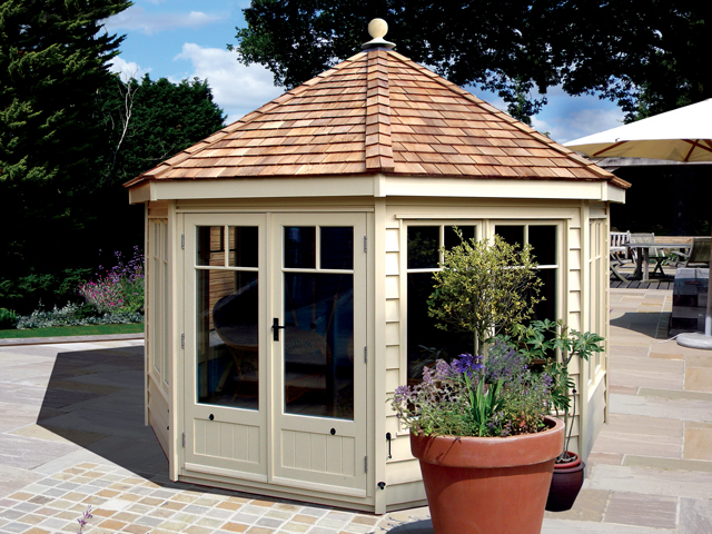 "<p id=""boldtitle"">Hip Roofed Octagonal </p> 10' x 10' (3050mm x 3050mm) hip roofed octagonal summerhouse.  Shown with optional window/door design, cedar shingle tiles and ridge finial.  Painted cream.<br/>"