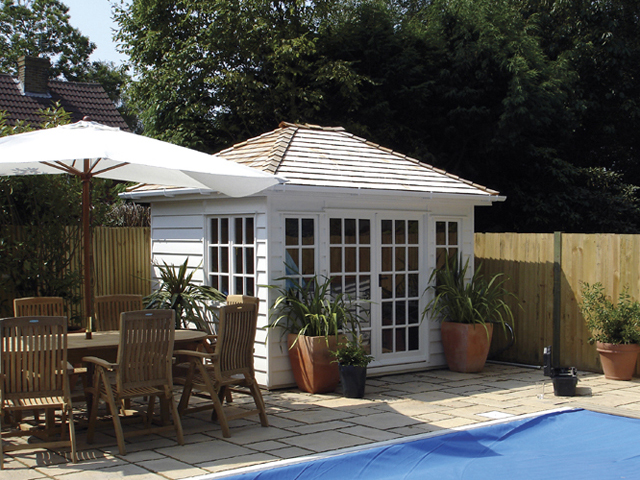 "<p id=""boldtitle"">Hip Roofed Summerhouse<br/></p>10' x 8' (3050mm x 2440mm) hip roofed summerhouse.  Shown with optional cedar shingle tiles and guttering.  Painted white.<br/>"