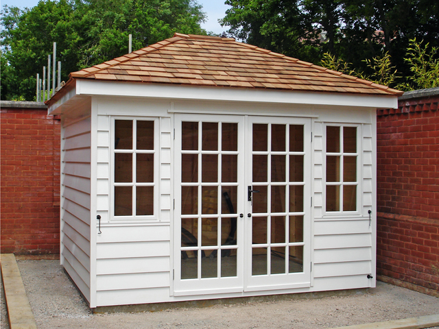 "<p id=""boldtitle"">Hip Roofed Summerhouse<br/></p>10' x 10' (3050mm x 3050mm) hip roofed summerhouse.  Shown with optional cedar shingle tiles and painted white.<br/>"
