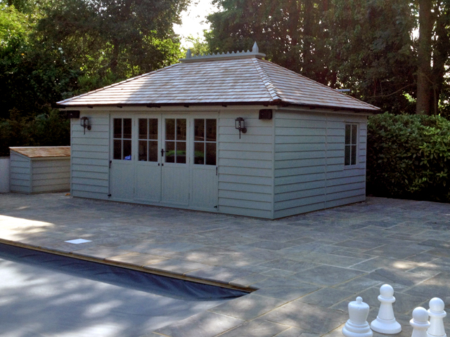 "<p id=""boldtitle"">Hip Roofed Summerhouse<br/></p>18' x 12' (5490mm x 3660mm) hip roofed summerhouse.  Shown with optional cedar shingle tiles, ridge finial and painted grey.<br/>"