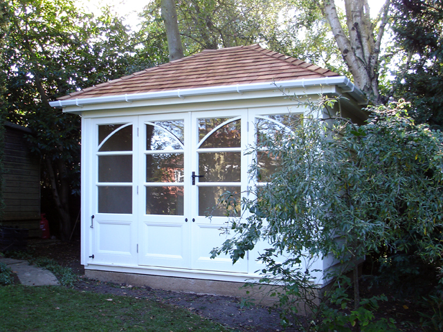 "<p id=""boldtitle"">Hip Roofed Summerhouse<br/></p>10' x 10' (3050mm x 3050mm) hip roofed summerhouse.  Shown with optional window/door design, cedar shingle tiles and guttering.  Painted white.<br/>"