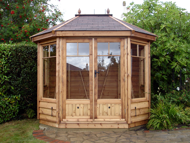 "<p id=""boldtitle"">Hip Roofed Octagonal </p>Hip roofed octagonal summerhouse.  Shown with optional ridge finial.  Treated in our standard medium brown preservative.<br/>"
