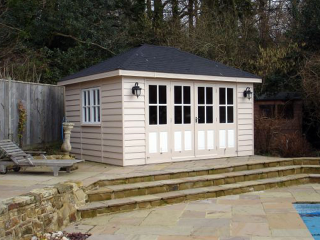 "<p id=""boldtitle"">Hip Roofed Summerhouse<br/></p>14' x 10' (4270mm x 3050mm) hip roofed summerhouse.  Shown with optional painted finish.<br/>"