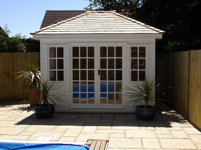 "<p id=""boldtitle"">Hip Roofed Summerhouse<br/></p>10' x 8' (3050mm x 2440mm) hip roofed summerhouse.  Shown with optional cedar shingle tiles and painted white.<br/>"