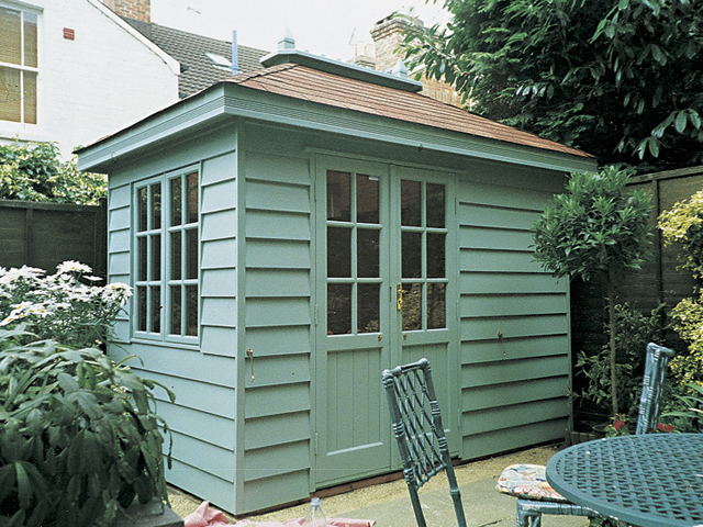 "<p id=""boldtitle"">Hip Roofed Summerhouse<br/></p> 9' x 6' (2745mm x 1830mm) hip roofed summerhouse.  Shown with optional ridge finial.  Painted.<br/>"