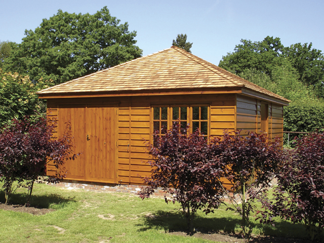 "<p id=""boldtitle"">Hip Roofed Summerhouse<br/></p>19' 6"" x 17' 6"" (5945mm x 5335mm) hip roofed summerhouse.  Shown with optional extra doors, internal T&G partition, cedar shingle roof tiles and stained.<br/>"