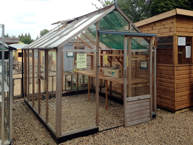 "<p id=""boldtitle"">Ex Display 10 x 8 Cedar Greenhouse</p>£ 1,499.00 inc vat and delivery (flat packed)<br/>Toughened Glass, One side staging, one side shelf, blinds.<br/>OR SENSIBLE OFFERS"